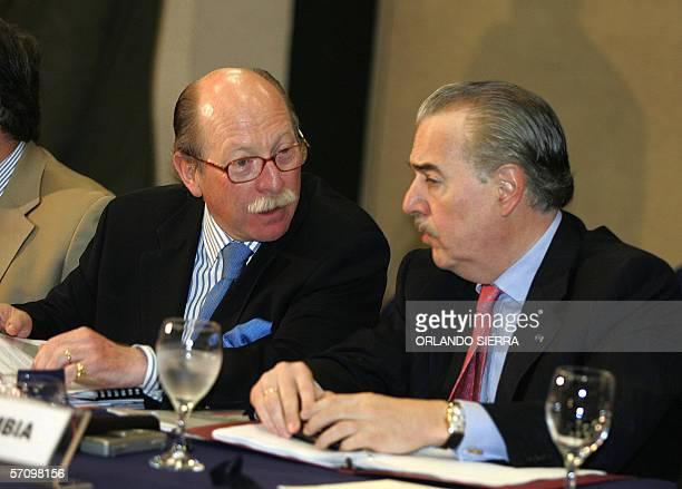 Camilo Reyes , vice canciller de Colombia, dialoga con el ex presidente colombiano Andres Pastrana, durante una reunion de cancilleres de 10 paises...