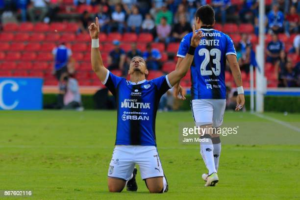 Camilo Sanvezzo of Queretaro celebrates with teammates after scoirng the first goal of his team during the 15th round match between Queretaro and...