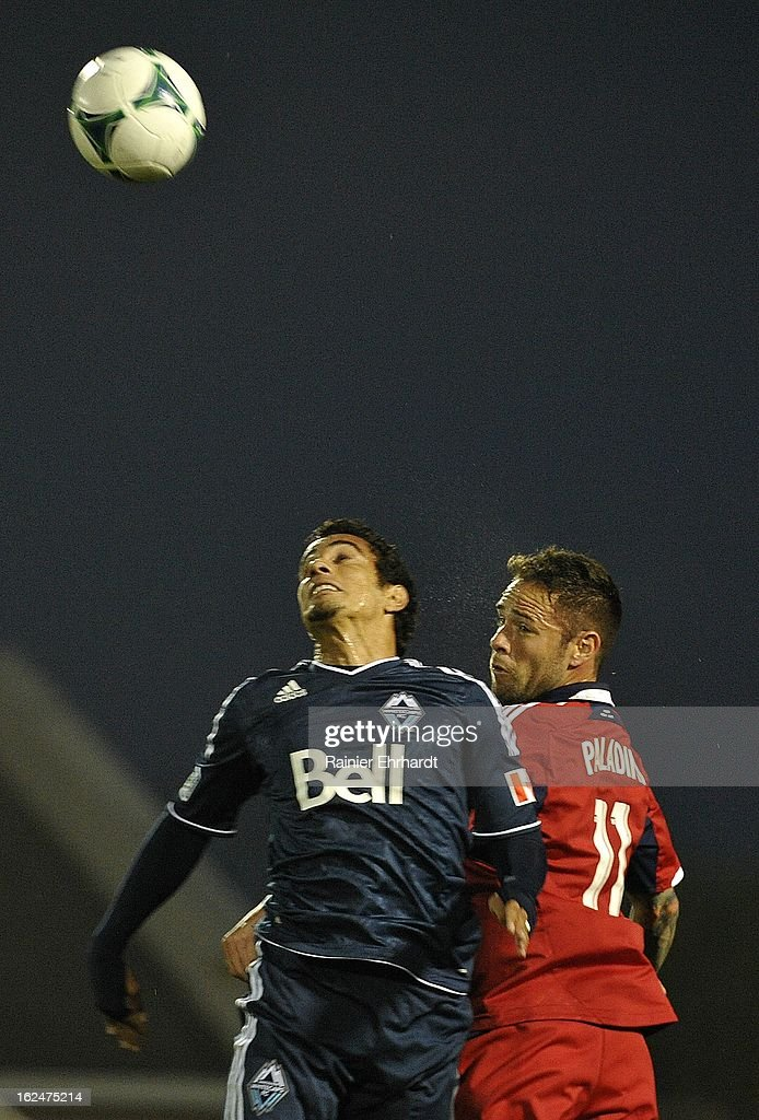 Camilo Sanvezzo #7 of the Vancouver Whitecaps FC and Daniel Paladini #11 of the Chicago Fire battle for a header during the second half of a game at Blackbaud Stadium on February 23, 2013 in Charleston, South Carolina.
