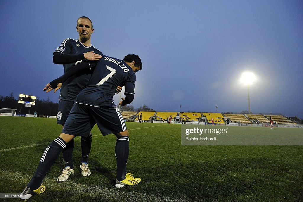Camilo Sanvezzo #7 of the Vancouver Whitecaps FC runs onto the field as teammate Kenny Miller #9 comes off during the second half of a game against the Chicago Fire at Blackbaud Stadium on February 23, 2013 in Charleston, South Carolina.