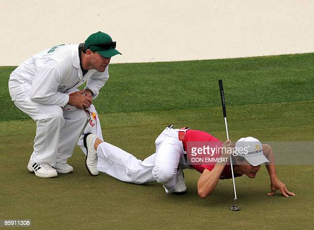 Camilo Villegas from Colombia and his caddie Gary Matthews line up a putt on the 9th hole during the 2nd round of the 2009 Masters at Augusta...