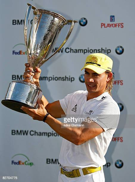 Camilo Villegas hoists the trophy after winning the BMW Championship on September 7 2008 at Bellerive Country Club in St Louis Missouri