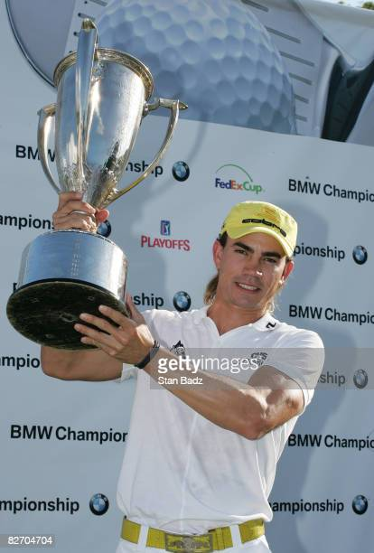 Camilo Villegas holds the winner's trophy after the final round of the BMW Championship held at Bellerive Country Club on September 7 2008 in St...