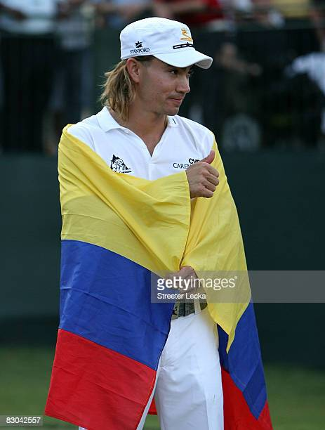 Camilo Villegas of Colombia celebrates after defeating Sergio Garcia of Spain in a playoff during the final round of THE TOUR Championship presented...