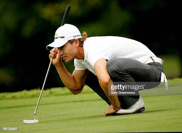 Camilo Villegas of Colombia lines up a putt for eagle on the 9th hole during the first round of the TOUR Championship at East Lake Golf Club on...