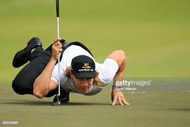 Camilo Villegas of Colombia lines up a putt on the 16th green during the third round of THE TOUR Championship presented by CocaCola at East Lake Golf...