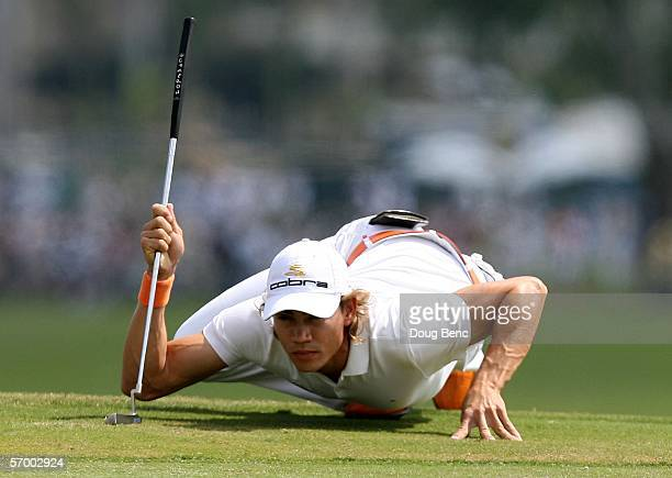 Camilo Villegas of Colombia lines up an eagle putt on the first green during the final round of the Ford Championship at Doral on March 5 2006 at...