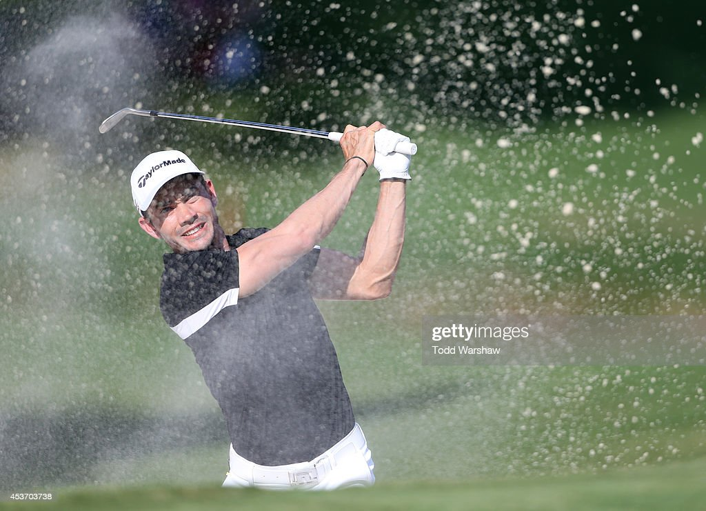 Camilo Villegas of Colombia plays a shot from the bunker on the 18th hole during the third round of the Wyndham Championship at Sedgefield Country Club on August 16, 2014 in Greensboro, North Carolina.