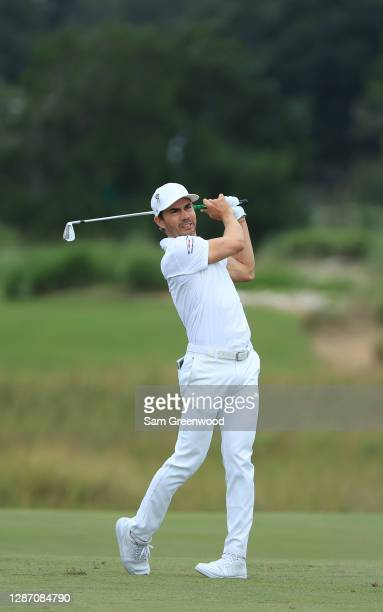 Camilo Villegas of Colombia plays a shot on the 13th hole during the final round of The RSM Classic at the Seaside Course at Sea Island Golf Club on...