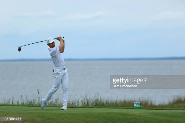 Camilo Villegas of Colombia plays his shot from the 14th tee during the final round of The RSM Classic at the Seaside Course at Sea Island Golf Club...