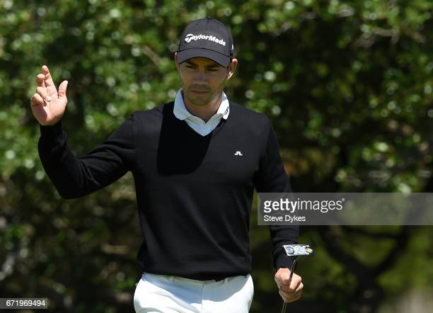 Camilo Villegas of Colombia reacts to his putt on the sixth hole during the final round of the Valero Texas Open at TPC San Antonio ATT Oaks Course...