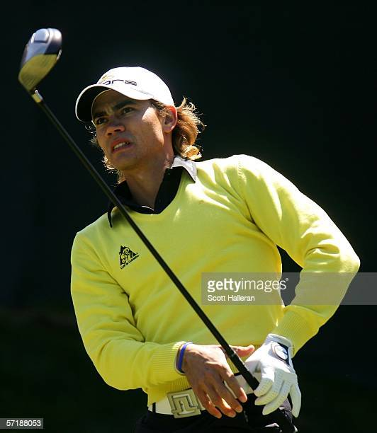 Camilo Villegas of Colombia watches his tee shot on the first hole during the final round of The Players Championships on the Stadium Course at TPC...