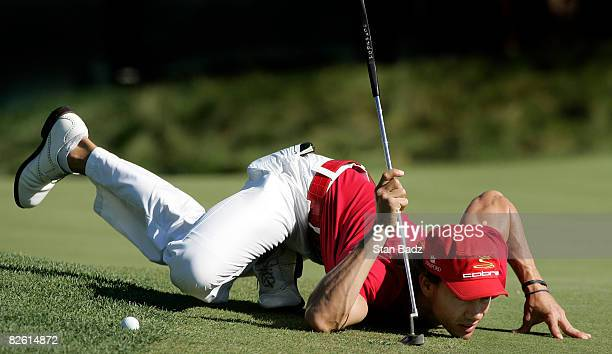 Camilo Villegas of Columbia lowers himself to the 18th green to check his putt during the third round of the Deutsche Bank Championship held at TPC...