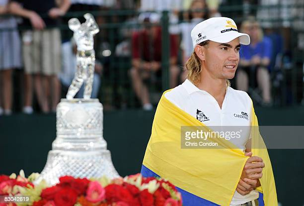 Camilo Villegas poses with the winner's trophy after winning THE TOUR Championship presented by CocaCola at East Lake Golf Club on September 28 2008...