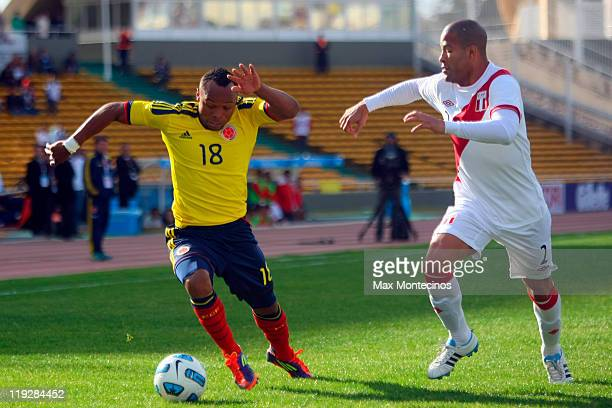 Camilo Zúñiga from Colombia fights for the ball with Alberto Rodríguez from Peru During a quarter final match between Colombia and Peru at Mario...