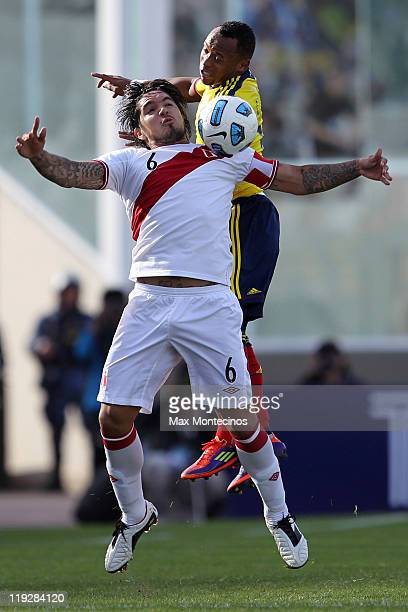 Camilo Zúñiga from Colombia fights for the ball with Juan Vargas from Peru During a quarter final match between Colombia and Peru at Mario Alberto...