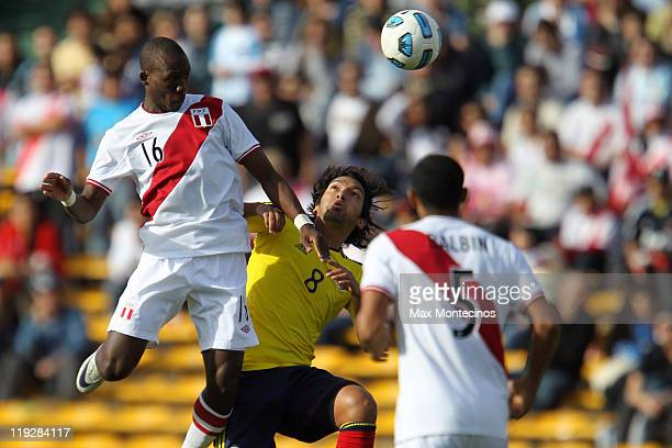 Camilo Zúñiga from Colombia fights for the ball with Luis Advíncula from Peru During a quarter final match between Colombia and Peru at Mario Alberto...