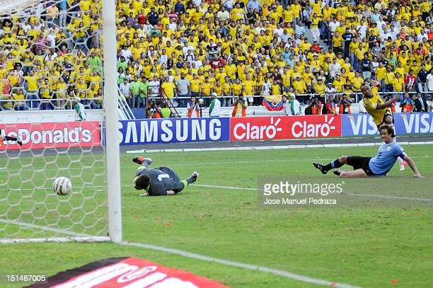 Camilo Zuñiga of Colombia shoots a goal during a match between Colombia and Uruguay as part of the South American Qualifiers for the FIFA Brazil 2014...