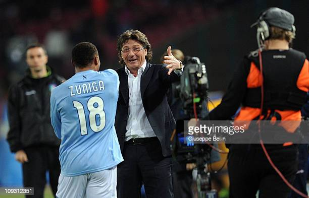 Camilo Zuniga and Walter Mazzarri head coach of Napoli celebrate after the opening goal during the Serie A match between SSC Napoli and Catania...