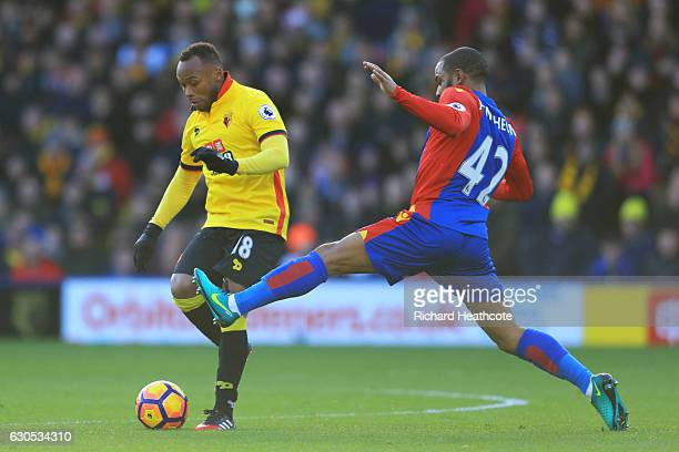 Camilo Zuniga of Watford battles for the ball with Jason Puncheon of Crystal Palace during the Premier League match between Watford and Crystal...