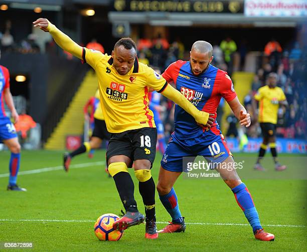 Camilo Zuniga of Watford is tackled by Andros Townsend of Crystal Palace during the Barclays Premier League match between Watford and Crystal Palace...