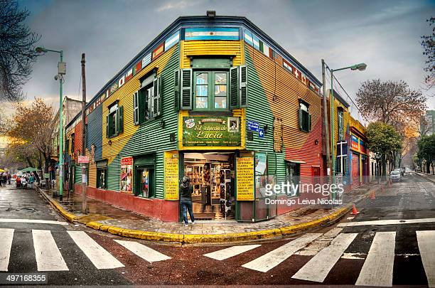 Caminito St, La Boca. The street is a major tourist attraction in Buenos Aires & the neighborhood is filled with colorfully painted buildings.