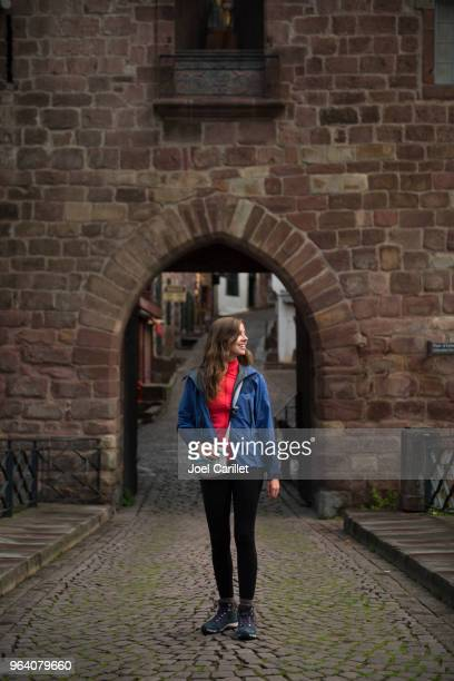 camino de santiago hiker newly arrived in saint-jean-pied-de-port, france - saint jean pied de port stock photos and pictures