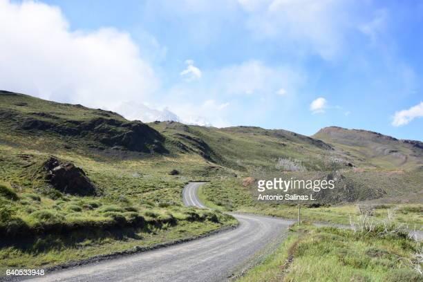 camino en parque nacional torres del paine - formación de roca stock pictures, royalty-free photos & images