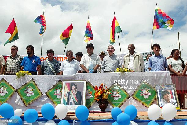 Bolivia's President Evo Morales sings his national anthem next to Cuban Minister of Education Luis Ignacio Gomez and Venezuelan Minister of Education...