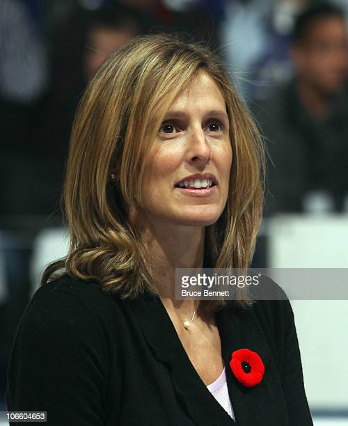 Cammi Granato is honored for her induction into the Hockey Hall of Fame prior to the game between the Toronto Maple Leafs and the Buffalo Sabres at...