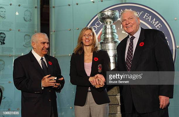 Cammi Granato is presented with her Hall of Fame ring by Jim Gregory and Don Hay at a media opportunity prior to her induction ceremony at the Hockey...
