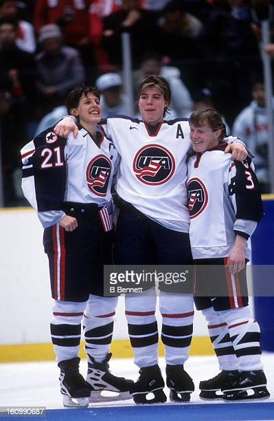 Cammi Granato Karyn Bye and Lisa BrownMiller of Team USA celebrate on the ice after the women's gold medal match against Team Canada at the 1998...