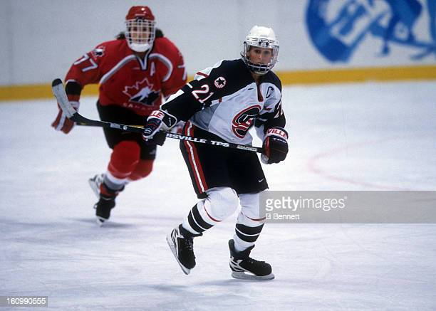 Cammi Granato of Team USA skates on the ice during the women's first round match against Team Canada at the 1998 Nagano Winter Olympics on February...