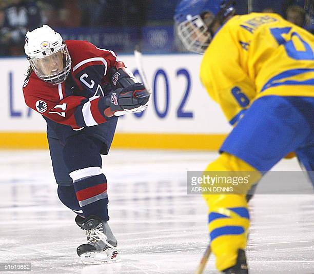 Cammi Granato of the US attempts to score as Sweden's Anna Andersson defends during their Women's Ice Hockey semifinal match at the XIX Winter...