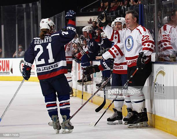 Cammi Granato of the USA Legends celebrates her goal with Claude Lemieux of the Canada Legends at the Legends Classic Hockey Game at the Air Canada...