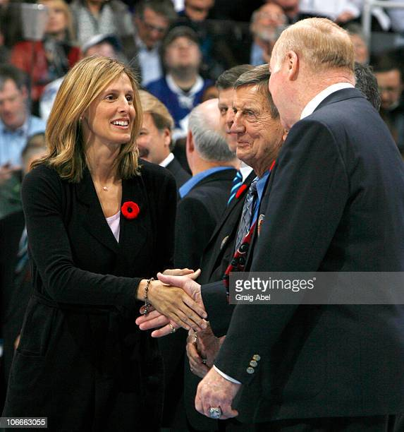Cammi Granato shakes hands with Red Kelly during a pregame ceremony prior to action between the Toronto Maple Leafs and the Buffalo Sabres November 6...