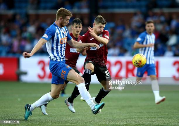 Cammy Smith of St Mirren battles with Stuart Findlay of Kilmarnock FC during the Betfred Scottish League Cup match between Kilmarnock and St Mirren...