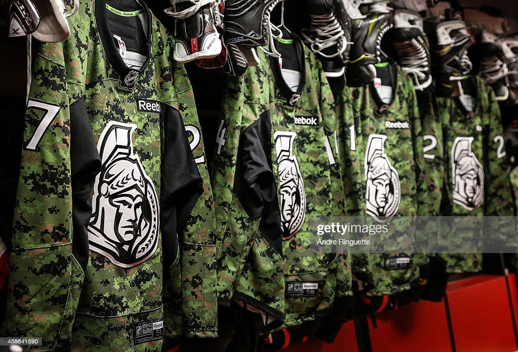 Camouflage Ottawa Senators warmup jerseys hang in the locker room on Canadian Forces Appreciation Night prior to an NHL game against the Winnipeg Jets at Canadian Tire Centre on November 8, 2014 in Ottawa, Ontario, Canada.