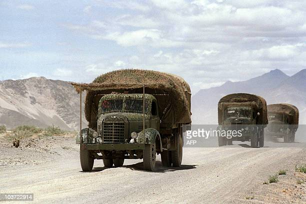 Camouflaged chinese army trucks move supplies towards the disputed ChineseIndian border in Zedang on June 15 in Tibet autonomous region