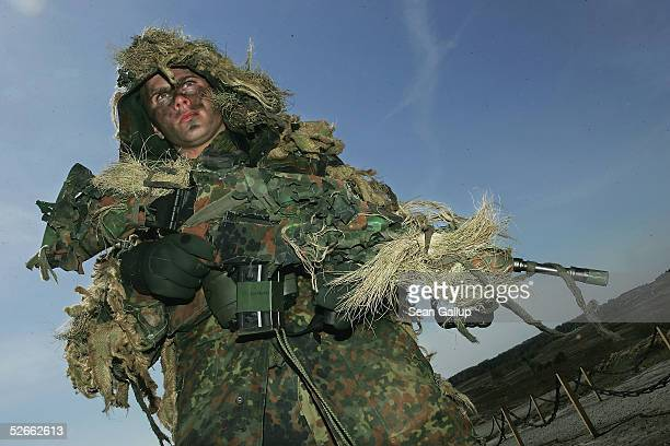 A camouflaged German army sniper participates in the European Challenge 2005 joint military exercises on April 20 2005 in Bergen Germany The...