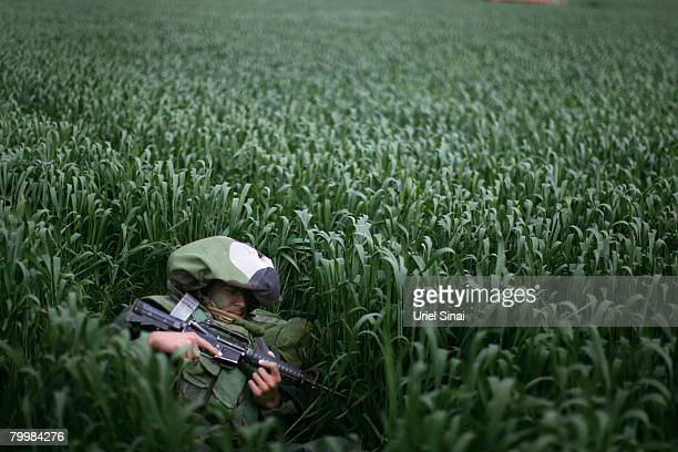 Camouflaged Israeli infantry troops deploy in a wheat field February 25 2008 near Kibbutz Nahal Oz on Israel's border with Gaza Israel deployed...