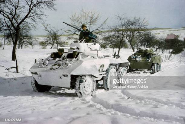 Camouflaged Light Armored Car M8 and one that was not Painted White ArdennesAlsace Campaign Battle of the Bulge 1945