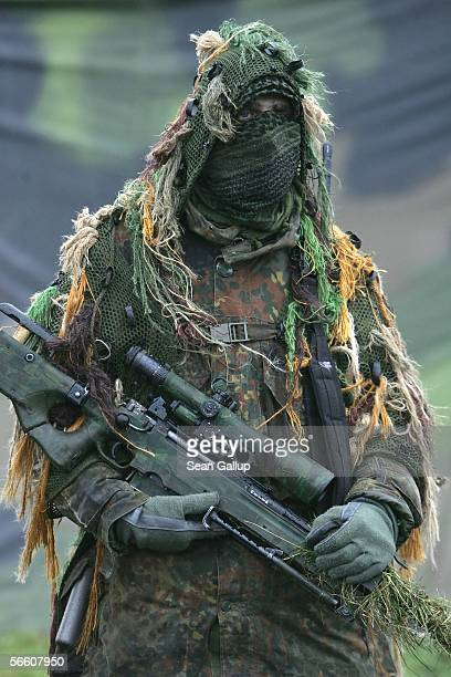 Camouflaged sniper of the German Lutfwaffe participates in a capabilities demonstration during the visit of German Defense Minister Franz Josef Jung...