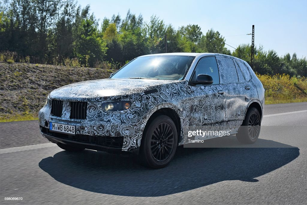 Camouflaged SUV on the highway : Stock Photo