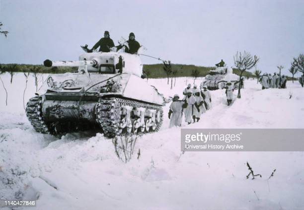 Camouflaged Tanks and Infantrymen Wearing Snow Capes Move Across SnowCovered Field ArdennesAlsace Campaign Battle of the Bulge 1945