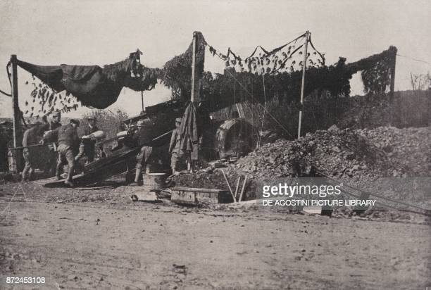 Camouflaging a large piece of artillery of the French Navy Spring Offensive World War I from L'Illustrazione Italiana Year XLV No 20 May 19 1918