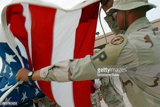 Camp As Saliyah Folding the American flag at the American Military Central Command As Saliyah is the US Army's largest prepositioning base outside of...