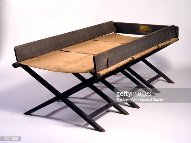 Camp bed said to have been used by George Washington at Valley Forge 1781 In three folding sections each with canvas top supported by Xshaped wooden...