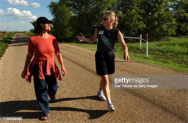 Camp CaseyTexasThursAug 18 2005 Minnesota Sen Becky Lourey and Colleen Rowley arrived late for the march so they walked on the road leading to the...