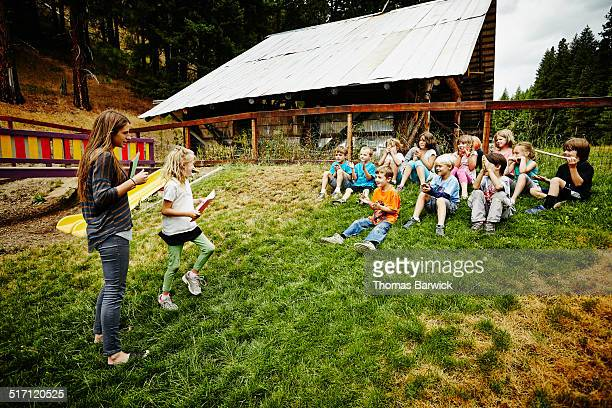 Camp counselor handing out awards to camp students
